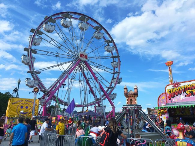 Amusement Park Arts Culture And Entertainment Ferris Wheel Amusement Park Ride Sky Cloud - Sky Large Group Of People Men Leisure Activity Fun Women Day Traveling Carnival Crowd Low Angle View Outdoors Real People Built Structure Carousel Adult