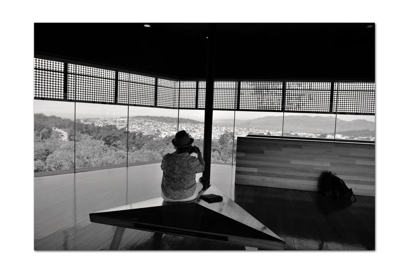 View From Observation Deck 2 DeYoung Museum 8th Floor Observation Tower Golden Gate Park San Francisco CA🇺🇸 Cityscape Parkview Bnw_friday_eyeemchallenge Scenic Lookout Bnw_thepeoplearoundus Woman Enjoys View Monochrome_Photography Monochrome Vista Black & White Black & White Photography Black And White Collection  Black And White Large Plate Glass Windows Wood Floors Bench Silhouettes Reflection Rear View