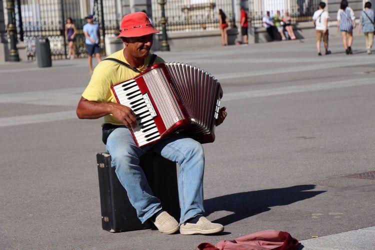 Street Musician Enjoying Life Hanging Out at Madrid,spain