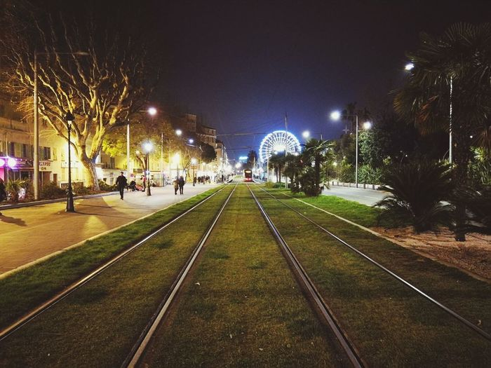 Tracks ahead. Grass Tracks Tramway Dark France Straßenbahn Côte D'Azur Tree Large Group Of People Sky City HUAWEI Photo Award: After Dark
