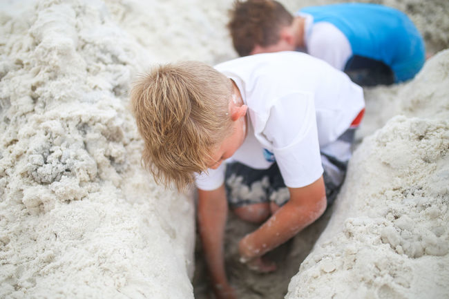 Boys digging a tunnel in the sand at the beach Child Childhood Real People Family Boys Lifestyles Leisure Activity Bonding Togetherness Brothers Sand Beach Tunnel Digging Digging In Sand Beach Fun Summer Beachlife Beach Life Blonde Hair Brown Hair