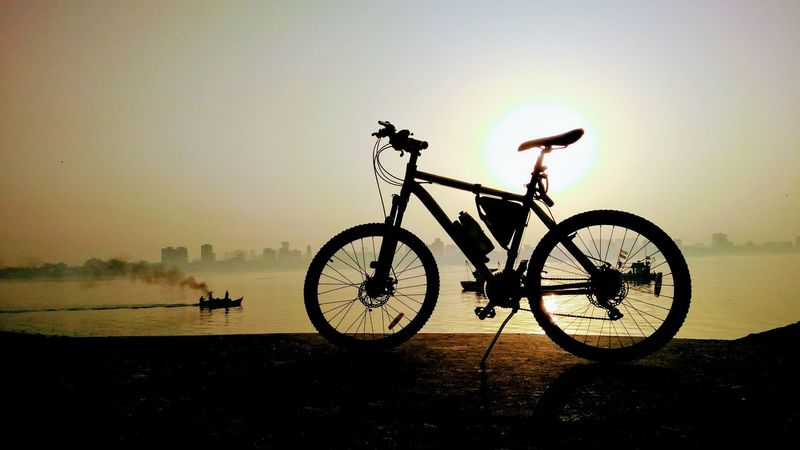 Sunrise Sunset Silhouette Bicycle Transportation Nature Outdoors Sky Vacations Scenics Adventure No People Beauty In Nature Bicycling Bicycle Trip Open Edit EyeEm Gallery Eyeem Mumbai EyeEm Nature Lover EyeEm Best Shots Tranquility Horizon Over Water Bicyclist Bicycles Bicyclelife Second Acts