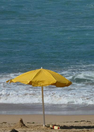 Yellow umbrella on beach