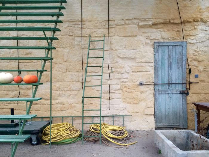Ladder and ropes against building at royaumont abbey