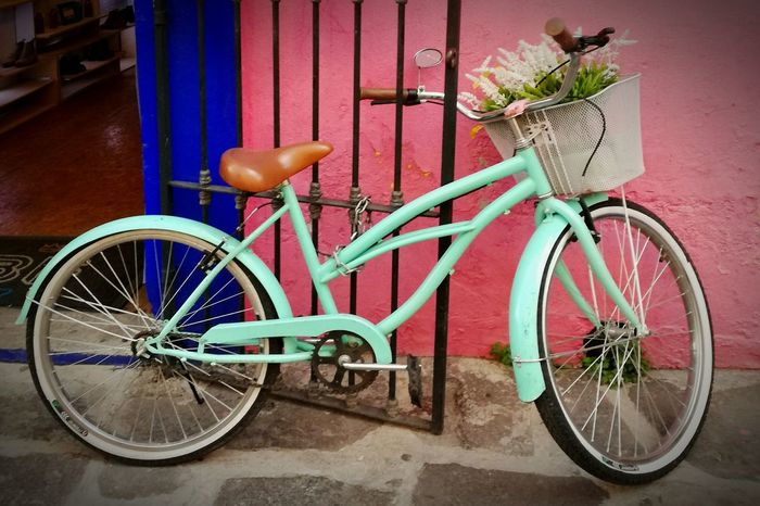 Bicycle Transportation Outdoors City Street Restaurant Color Flowers Life Is Good Tourism Walking Around Vibrant Color Life Close-up Day Building Exterior Tranquility No People Streetphotography Land Vehicle Stationary Mode Of Transport Bouquet Of Flowers Pink Mint Green