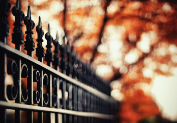 Low angle view of metal railing against defocused background