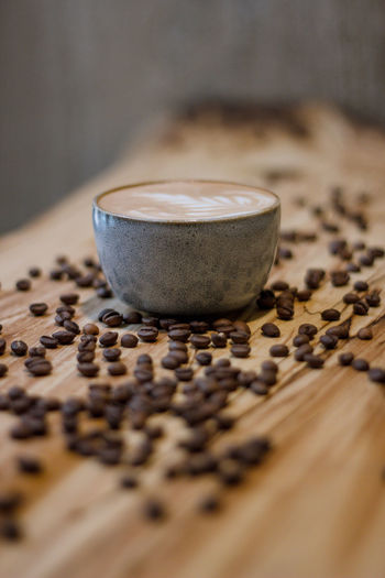 Coffee Coffee - Drink Coffee Cup Coffee Time Coffee Break Food And Drink Indoors  No People Selective Focus Drink Cup Close-up Still Life Refreshment Mug Food Freshness Roasted Coffee Bean Table Hot Drink Cappuccino Wood - Material Latte Caffeine Non-alcoholic Beverage