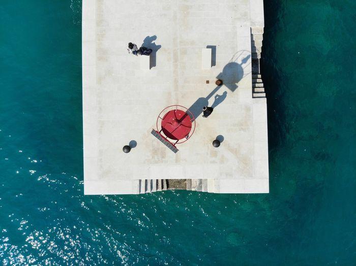 Aerial view of promenade by sea