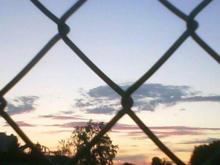 The Traveler - 2015 EyeEm Awards The Great Outdoors - 2015 EyeEm Awards Orlando Sunset Theme Park Gates Fences Caged Caged Beauty Gated Sunset