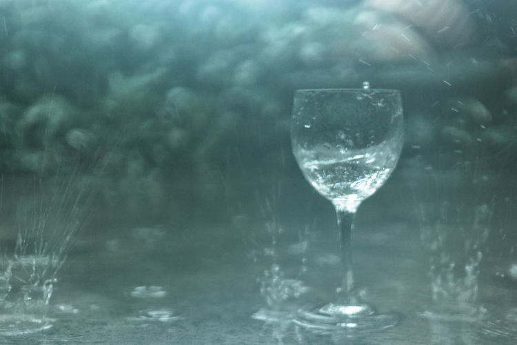 wine glass in the rain Abstract Blur Blurry Drop Fall Glass Glass - Material Glowing Imagination Lens Flare Motion Mystery Outdoor Power In Nature Purity Rain Reflection Shiny Splashing Spray Transparent Water Weather Wet Wineglass