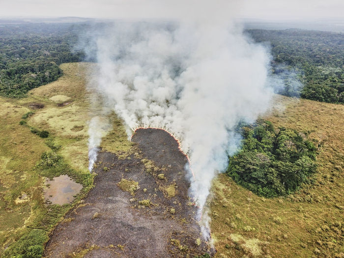 High angle view of smoke emitting from volcanic landscape