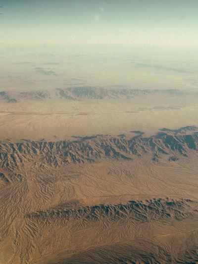 Aerial view of sand dunes in desert against sky