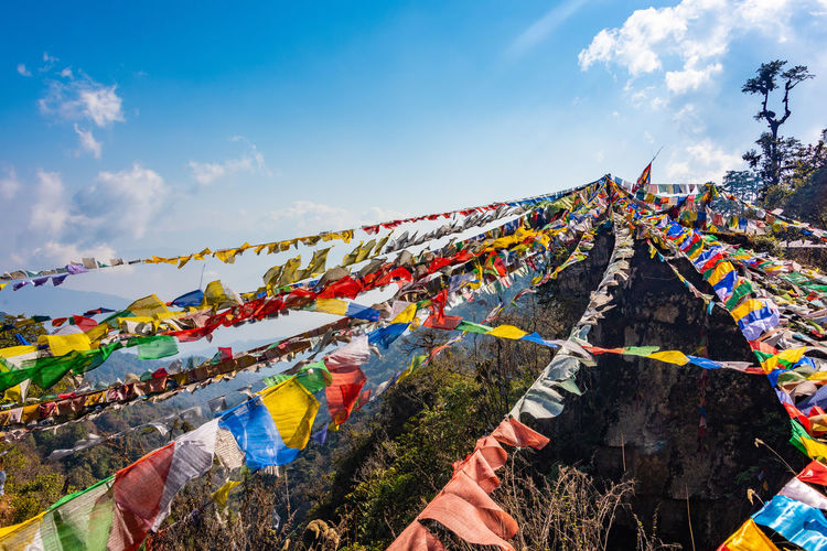 Waving Prayer Flags Bhutan Buddhism Prayer Flags  Multi Colored Sky Cloud - Sky Religion Belief Spirituality Flag Nature Hanging Day Decoration Low Angle View Wind Outdoors Celebration Place Of Worship Prayer Cloth Mountains ASIA Tree