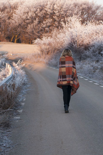 One Person Full Length Walking Plant Rear View Road Winter Lifestyles Real People Day Cold Temperature Tree Nature The Way Forward Standing Direction Motion Transportation Outdoors Warm Clothing
