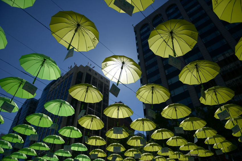Low Angle View Umbrella Hanging No People Lighting Equipment Protection Pattern Large Group Of Objects Yellow Sky Decoration Nature Lantern In A Row Abundance Security Outdoors Illuminated Chinese Lantern Umbrellas