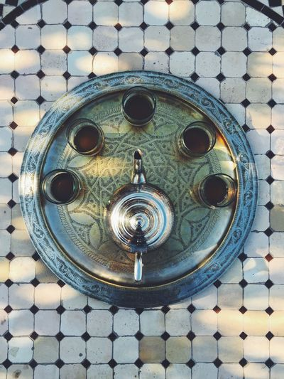 Overhead view of tea pot and cups on tray