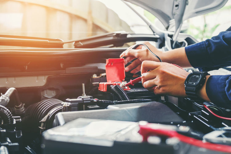 Auto Repair Shop Car Close-up Day Holding Human Body Part Human Hand Land Vehicle Men Mode Of Transport One Person Outdoors People Real People Transportation