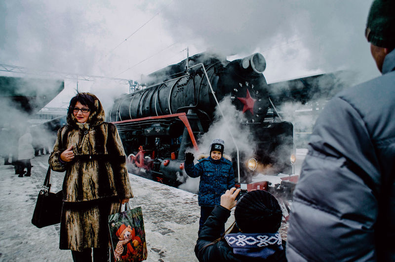 Group Of People Smoke - Physical Structure Women Winter People Real People Adult Clothing Day Snow Motion Incidental People Nature Young Adult Warm Clothing Walking Standing Cold Temperature Men Train Rail Transportation Railway Station