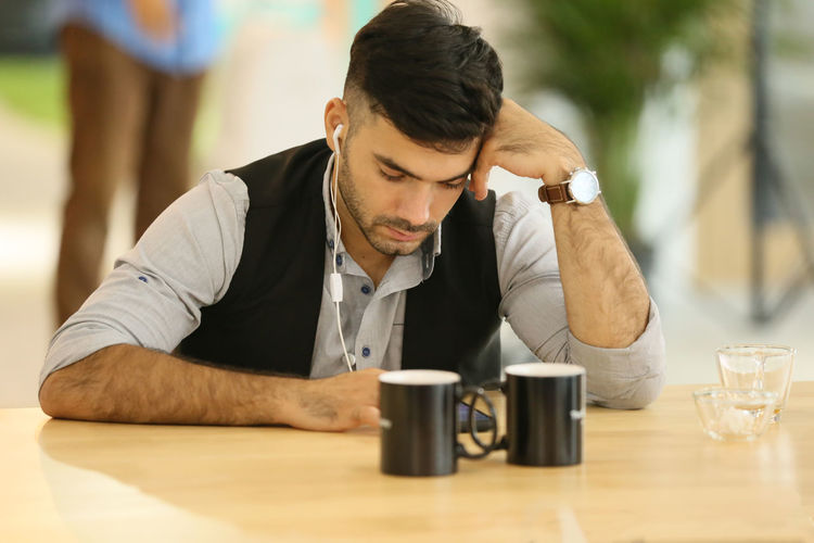 Side view of a man drinking coffee
