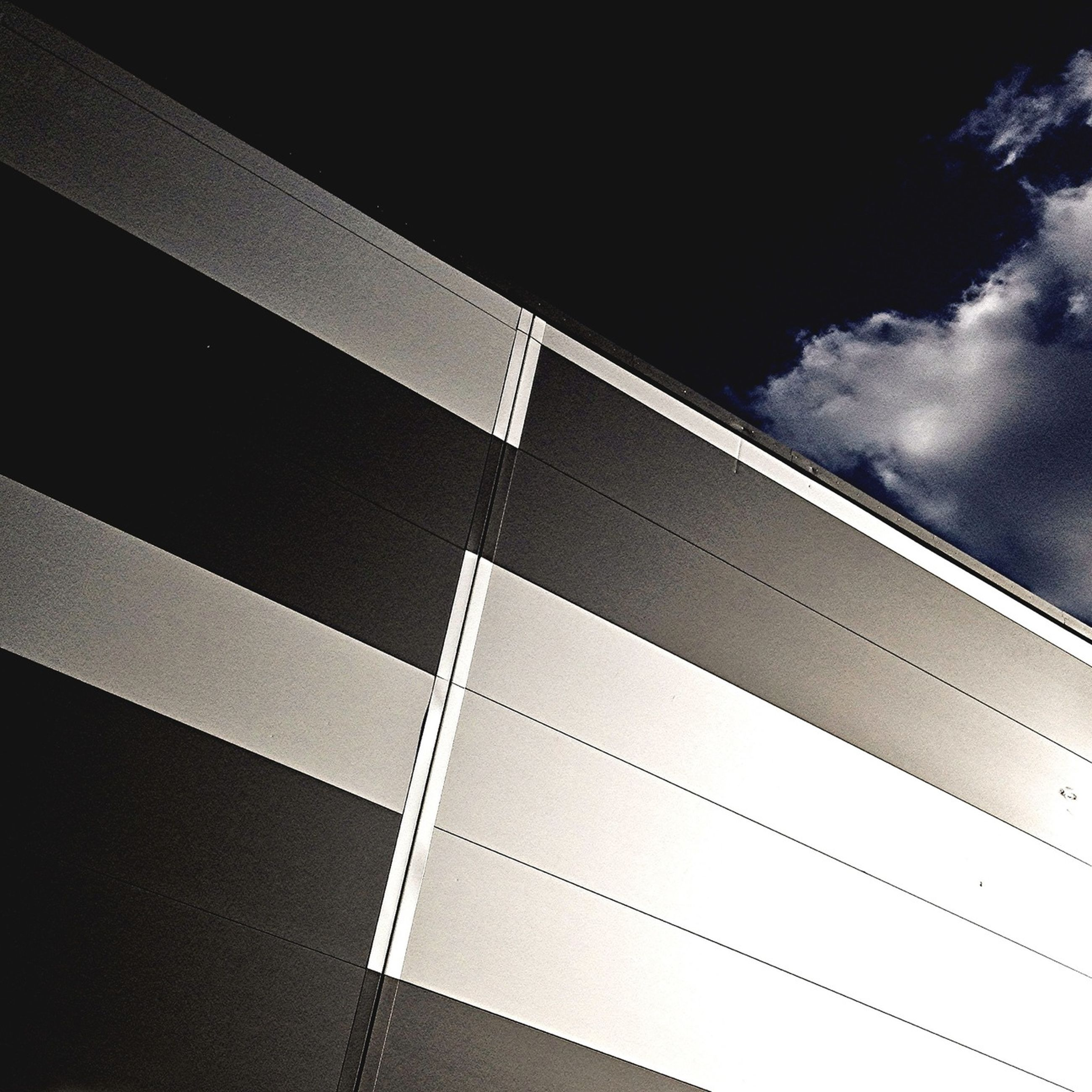 low angle view, sky, built structure, architecture, cloud - sky, no people, pattern, modern, connection, outdoors, cloudy, day, part of, ceiling, directly below, transportation, building exterior, tilt, cloud