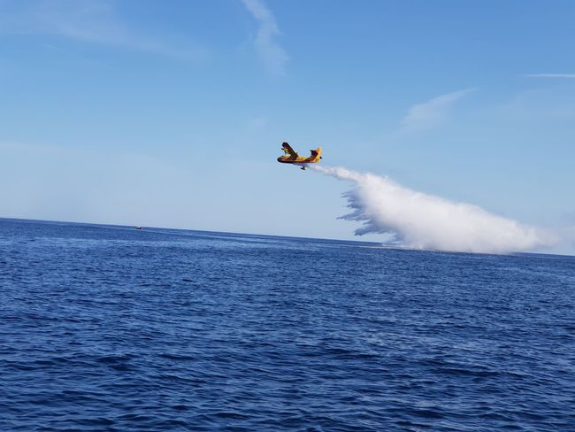 fire plane Fire Plane Fire Plane Corsica Water Flying Motion Mid-air Stunt RISK Blue Spraying Speed Sky