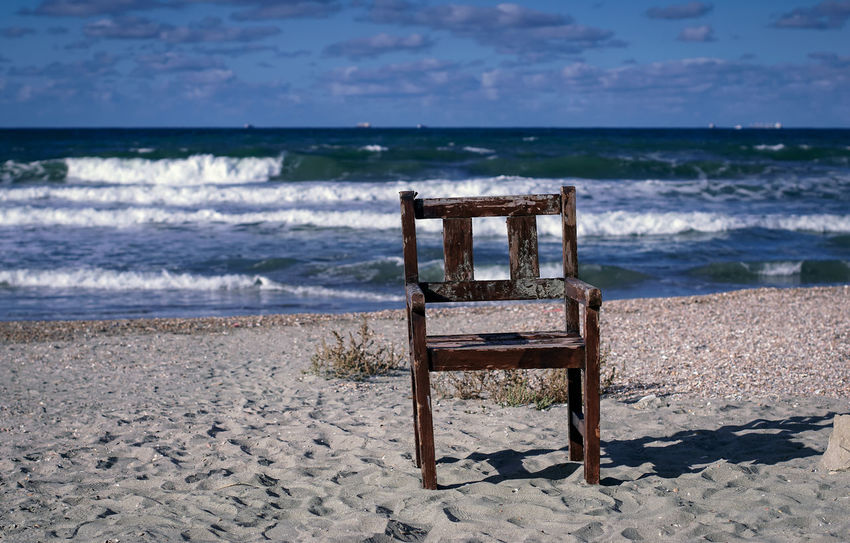 Beach Sea Land Seat Water Sand Nature Horizon Over Water Chair Beauty In Nature Horizon Tranquility Wave Motion No People Empty Absence Scenics - Nature Sky Outdoors