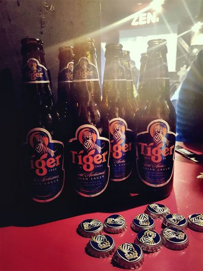 Glass Bottles With Friends Larger Nightphotography EyeEm Gallery Tiger Beers Hang Out No People Variation Shelf Store Hanging Close-up