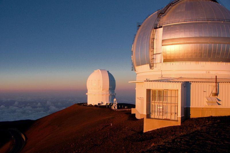Mauna Kea Observatory Against Blue Sky At Sunset