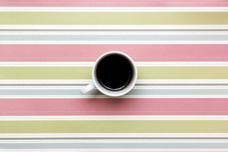 A cup of coffee on colorful background. Black Coffee Close-up Coffee - Drink Coffee Cup Coffee, Isolated, Take, Away, To, Go, Cup, Paper, Takeaway, Cap, Background, Bar, Beverage, Break, Cafe, Caffeine, Cappuccino, Latte, Mocha, Cardboard, Container, Convenience, Copy, Design, Detail, Disposable, Drink, Energy, Grab, Espresso, Fast, Food, He Cup Day Directly Above Drink Food And Drink Freshness Indoors  No People Pink Color Refreshment Studio Shot Table
