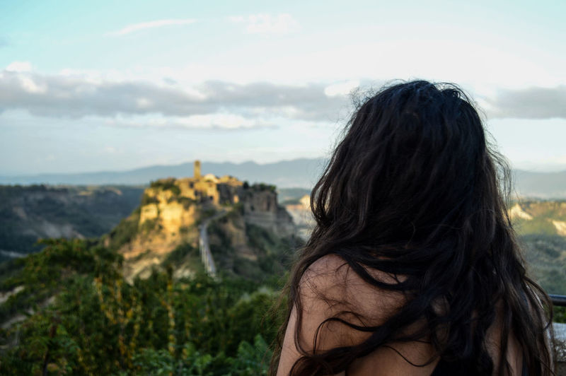 Shirtless woman against landscape