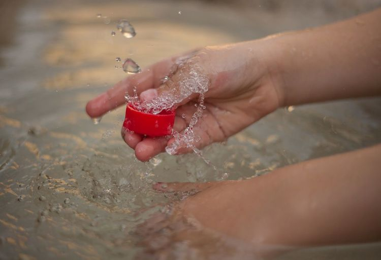 Close-up of woman hand in water