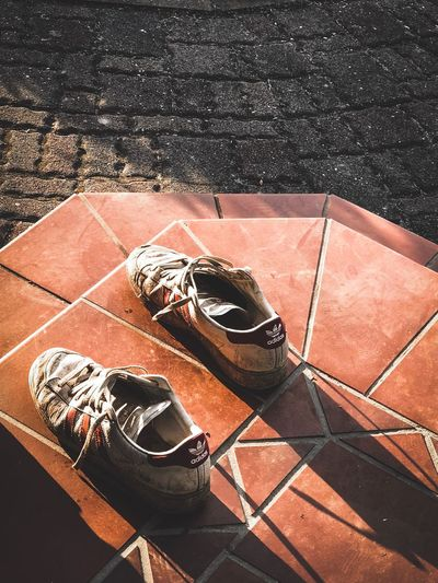 Lost High Angle View Sunlight Day No People Outdoors Shadow Security Still Life Sunny Shoe Close-up