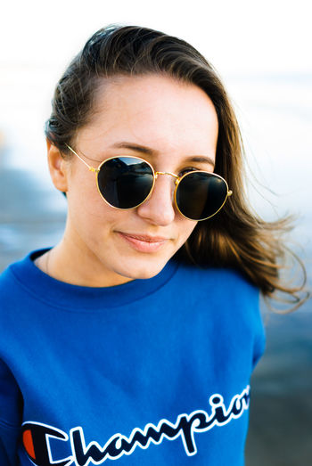 Portrait Sunglasses One Person Headshot One Woman Only Looking At Camera Only Women People Brown Hair Long Hair Casual Clothing Adult Front View Child Day Outdoors Childhood T-shirt Leisure Activity Arts Culture And Entertainment