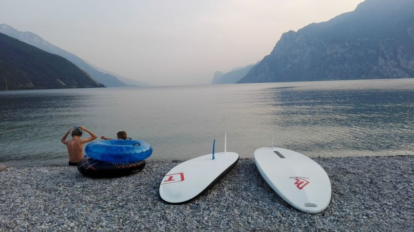 Relaxing Friends Friendship Hello World Lake Sports Sport Surfing Surf Sky Sky And Lake No Filter No Edit Enjoying Life Details Two Objects Two People Two Colours Torbole Lake Italy Aventure Time Adventure Club Swimming