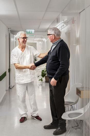 Friends standing in corridor