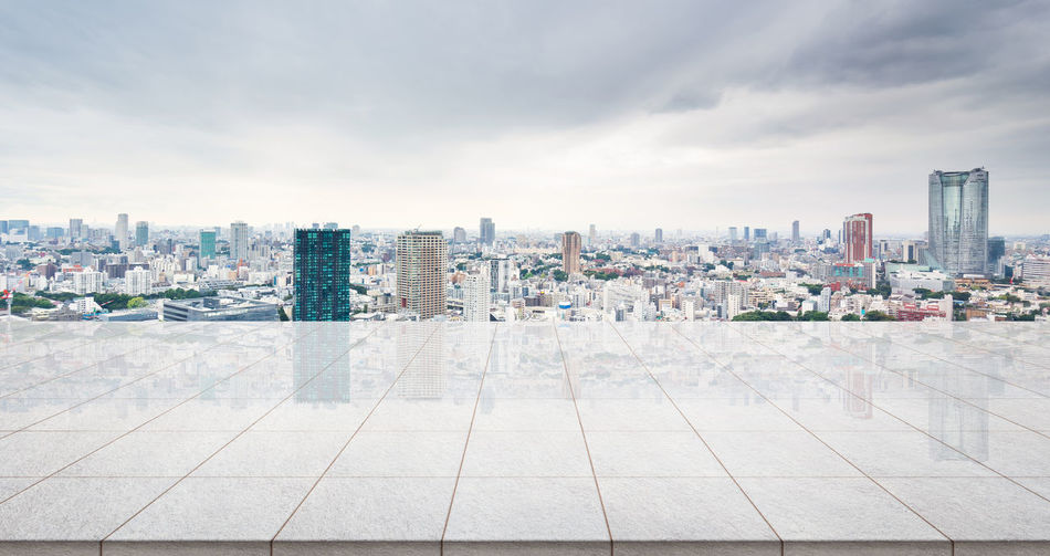 Business concept - Empty marble floor top with panoramic modern cityscape building bird eye aerial view under sunrise and morning blue bright sky of Tokyo, Japan for display or montage product Architecture Building Exterior Built Structure City Cityscape Day Downtown District Empty, Marble, Rock, Tile, Stone, Floor, Ground, Nobody, Background, Mockup, Mock Up, Template, Display, Montage, Product, Layout, Design, Texture, Blank, Japan, Tokyo, Cityscape, Landmark, Real Estate, Morning, Building, Skyline, Skyscraper, Business, Ci No People Outdoors Sky Skyscraper Travel Destinations Urban Skyline
