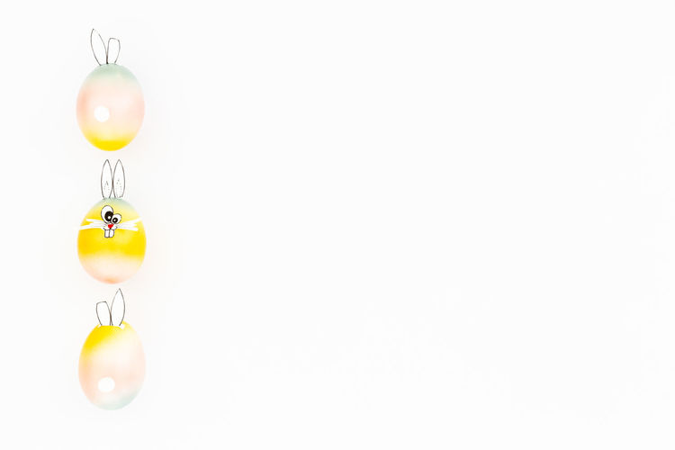 Close-up of multi colored lights on white background