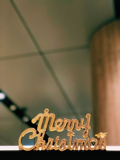Wording Christmas MerryChristmas Gold Colored No People Indoors  Focus On Foreground Close-up Communication Western Script Text