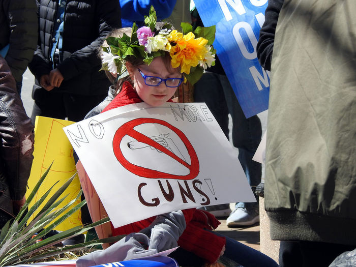 A young girl attending the pro- gun control March For Our Lives in Washington, DC on March 24, 2018. Protest Activism Bouquet Childhood Day Flower Girls Gun Control Gun Safety Lifestyles March For Our Lives Mass Shooting One Person Outdoors People Real People