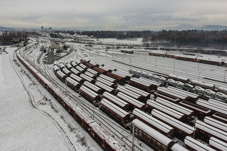 Cargo City Cityscape Europe Freight Highline Industry Long Marshalling Nature New Rail Railroad Railway Skyline Snow Station Track Traffic Train Transport Transportation Wagons Winter Yard Yards Cold Temperature Rail Transportation Sky Railroad Track High Angle View No People Day Environment Outdoors Covering Beauty In Nature Train - Vehicle Shunting Yard
