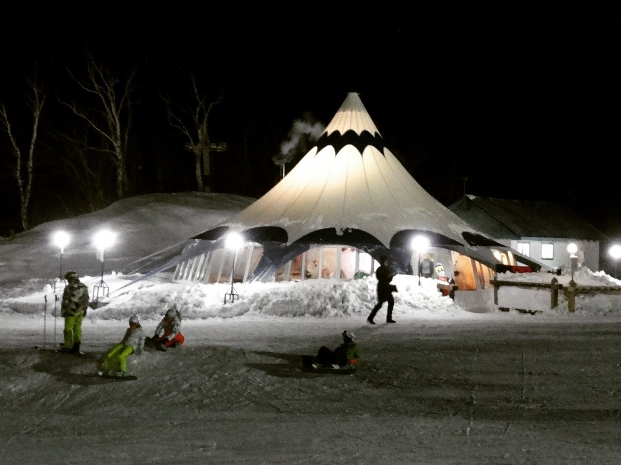 night, real people, cold temperature, snow, group of people, winter, illuminated, nature, transportation, men, outdoors, adventure, architecture, group, people, built structure, leisure activity, women, medium group of people, snowcapped mountain