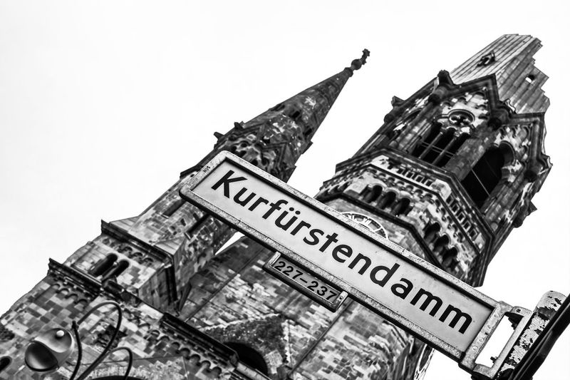 Berlin Photography Cathedral Church Kaiser-Wilhelm-Gedächtnis Kirche Kudamm Architecture Berliner Ansichten Black And White Blackandwhite Building Building Exterior Built Structure Capital Cities  City Clear Sky Communication Day Famous Place History Kurfürstendamm Low Angle View Nature No People Outdoors Place Of Worship Religion Sign Sky Street Sign Text Tilt Western Script #urbanana: The Urban Playground