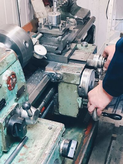 Hobby and craft Lathe Mechanic Craft Hobby Equipment Artisan Real People One Person Working Indoors  Industry Human Body Part Machinery Hand Human Hand Technology Workshop Factory Finger Industrial Equipment Manufacturing Equipment