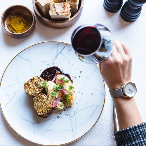 Food And Drink Food Drink Freshness Table One Person Indoors  Plate Human Hand High Angle View Refreshment Meal Hand Ready-to-eat Human Body Part Healthy Eating Eating Utensil Holding Kitchen Utensil Bread Glass Breakfast Red Wine Watch Wine Wineglass