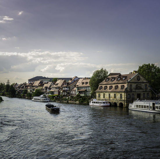 Buildings By Canal Against Sky At Bamberg