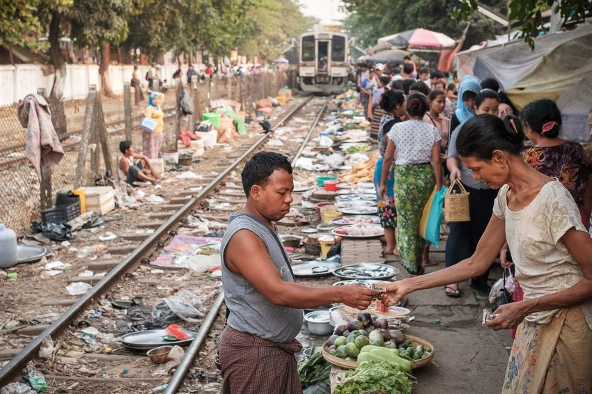 Transaction just before the train arrival at the Dayingone Circular train station in Yangon Myanmar. Myanmar Yangon People Streetphotography Travel Documentary Storytelling Group Of People Real People Large Group Of People Crowd Lifestyles Selling Market Street Market Buying