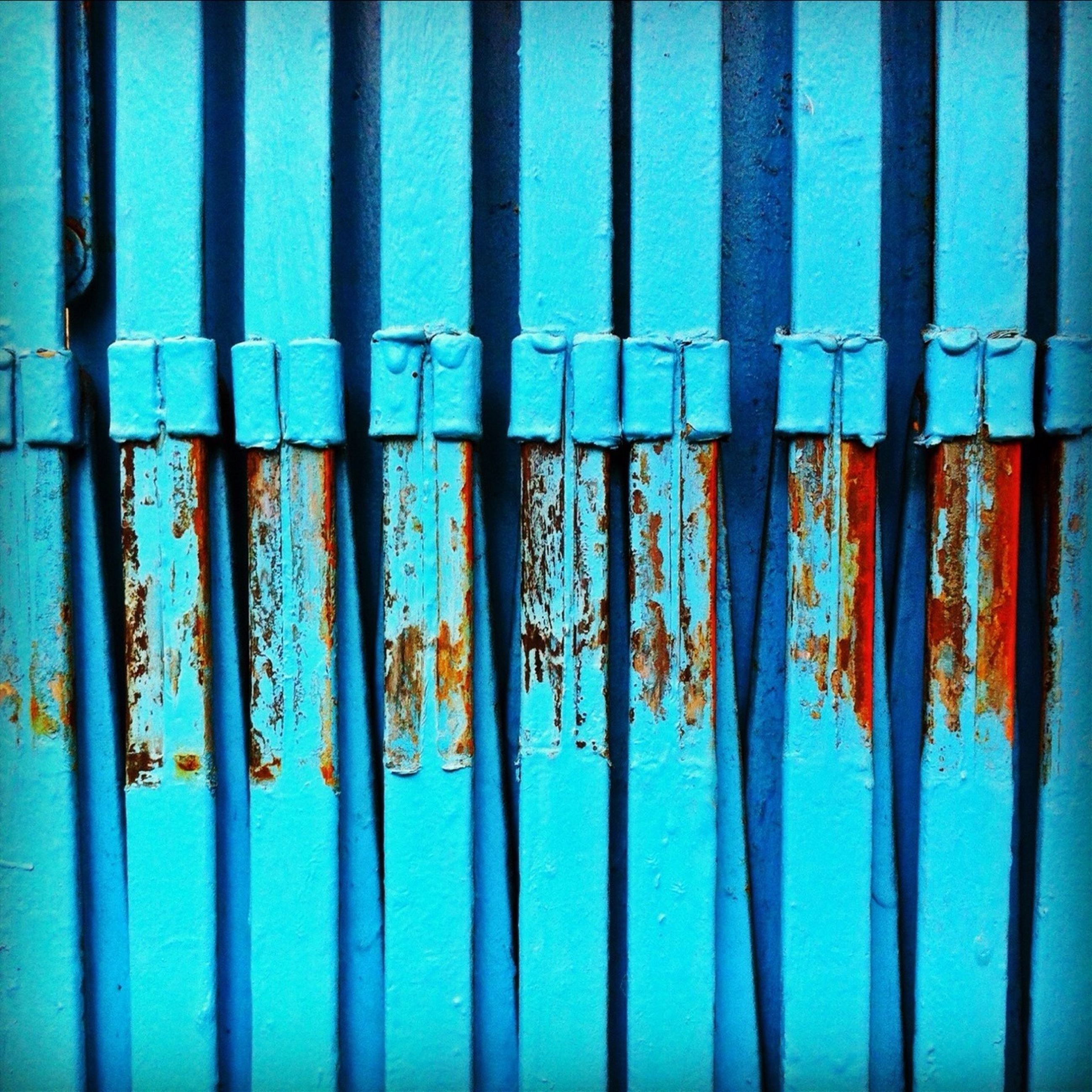 blue, full frame, architecture, built structure, metal, backgrounds, wall - building feature, multi colored, building exterior, protection, fence, pattern, safety, metallic, wall, weathered, rusty, day, graffiti, outdoors