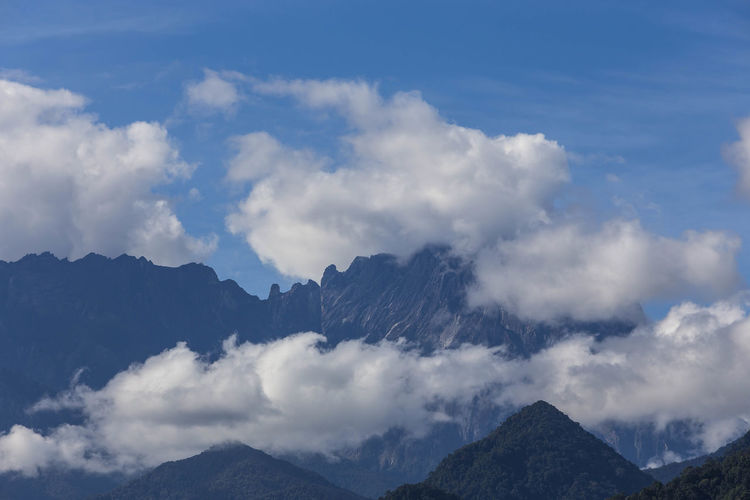 Clouds formation over peak of Mt. Kinabalu. Mountain Cloud - Sky Sky Beauty In Nature Scenics - Nature Mountain Range Tranquil Scene Nature Non-urban Scene Tranquility No People Environment Outdoors Idyllic Landscape Day Majestic Physical Geography Rock Mountain Peak Formation Mt. Kinabalu Sabah Malaysia Cloudscape