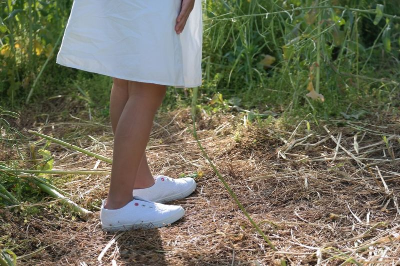 Low Section Human Leg One Person Real People Women Outdoors Lifestyles Leisure Activity Day Barefoot Standing Nature Grass Young Women Close-up Adult People Adults Only Out Of The Box Unedited Photo