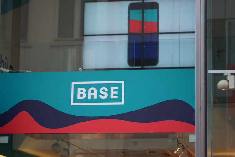 Brussels, Belgium - December 9, 2017: Base logo. BASE is the third largest of Belgium's three mobile telecommunications operators. Subsidiary of Telenet, it competes with Proximus and Orange Belgium Belgique Belgium Brussels Bruxelles Belgian  Brand Communication Mobile Communications Mobile Telephone Telecommunications